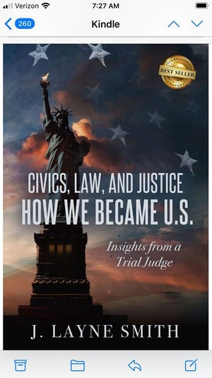 """Judge Layne Smith has a book, """"Civics, Law, and Justice."""""""
