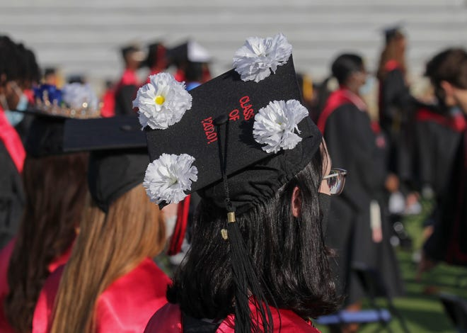 Graduating seniors from Port St. Lucie High School participate in the school's in-person commencement ceremony on Thursday, July 2, 2020, at Lawnwood Stadium in Fort Pierce. More than 390 seniors were candidates for graduation in the class of 2020, but the COVID-19 virus cut short the end of the school year, and delayed the formal in-person graduation ceremonies until this week. The participating graduates walked across the stage, but did not collect diplomas, or handshakes, with the school staff as a precaution to help prevent the spread of the virus.