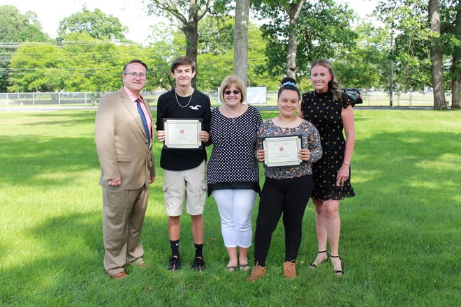 Matthew Sooy and Aryanna Bunton, both eighth-graders at Lakeside Middle School, placed first and second, respectively, in the annual Delta Sigma Theta Sorority's essay contest for Cumberland County. Pictured at the presentation are, from left, Spike Cook, principal, Lakeside Middle School, Matthew Sooy, Melissa Sooy, Matthew's mother and an eigth-grade English teacher at Lakeside, Aryanna Bunton, and Amanda Gaunt, eighth-grade vice principal at Lakeside.