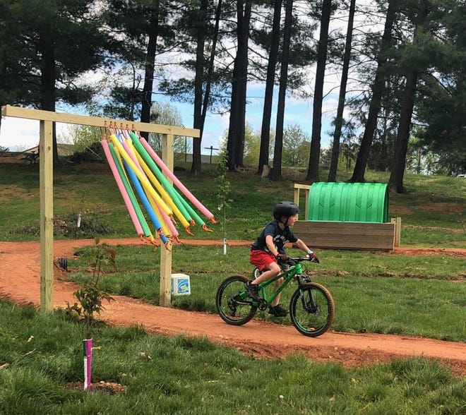 The Adventure Center of Asheville and Kolo Bike Park have reopened at limited capacity and with COVID-19 safety protocols in place. After pulling their application for a special use permit to build mountain bike trails on steep slopes near the Blue Ridge Parkway, developers plan to move forward with a bike park they say will now look more like Kolo Bike Park.