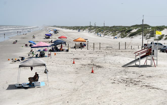 People go to the beach, Friday, July 3, 2020, at Bob Hall Pier. The city of Corpus Christi closed vehicle access to parks and beaches Friday, July 3 to Tuesday, July 7 to prohibit crowding for the Fourth of July weekend.