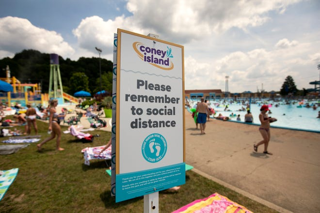 Coney Island Sunlite Pool is open and lots of people escaped the heat by diving into the cool water, Friday, July 3, 2020. People cannot wear masks in the water, but social distancing is encouraged.