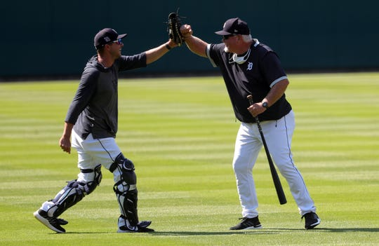 The Detroit Tigers held workouts at Comerica Park Friday, July 3, 2020. Bullpen catcher Jeremy Carroll high-fives manager Ron Gardenhire in center field as the team prepares for the shortened 2020 season.