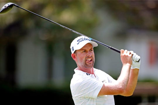 Webb Simpson plays his shot from the fifth tee during the second round of the Rocket Mortgage Classic golf tournament at Detroit Golf Club, July 3, 2020.