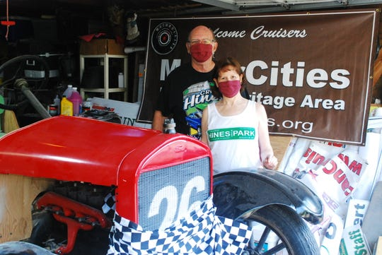 Don and Gayle Nicholson pose in face masks after Gayle fashioned a checkered-flag mask for their 1926 Model T on July 3, 2020 - although they had to cancel this summer's Cruisin' Hines car event (Source: Edward Nicholson).