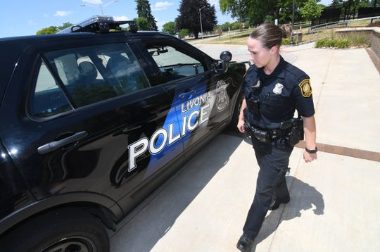 Livonia Police officer Carlin O'Malley checks her police cruiser before heading on patrol in Livonia on Friday, July 3, 2020.