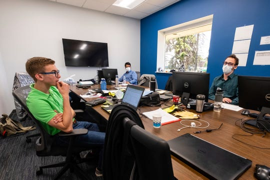 Interns Adam Tuckey, left, Akhil Sabhabadhi, center, and Gabe Vivian work in an office at P.J. Wallbank Springs in Port Huron.
