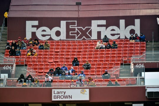 In this Dec. 9, 2018 photo, fans at FedEx Field watch a game between the Washington Redskins and the New York Giants in Landover, Md.