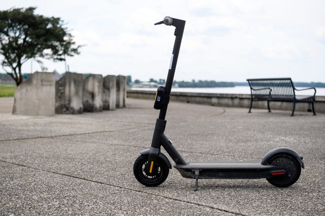 An e-scooter is left near the Four Freedoms Monument along the riverfront in Downtown Evansville in July 2020.