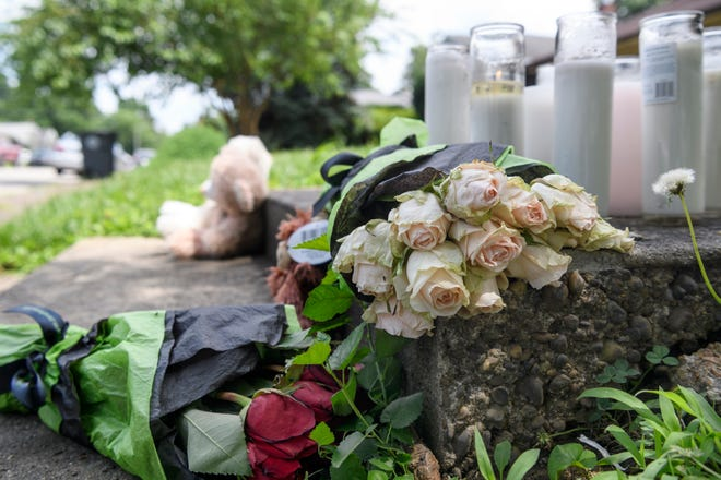 A memorial that includes balloons, candles, roses and teddy bears is left outside of the home of 53-year-old Bobbie Rice and her 23-year-old daughter Whitney Allen who were killed in a shooting at their home on the 1000 block of East Chandler Avenue, Saturday morning, June 27.