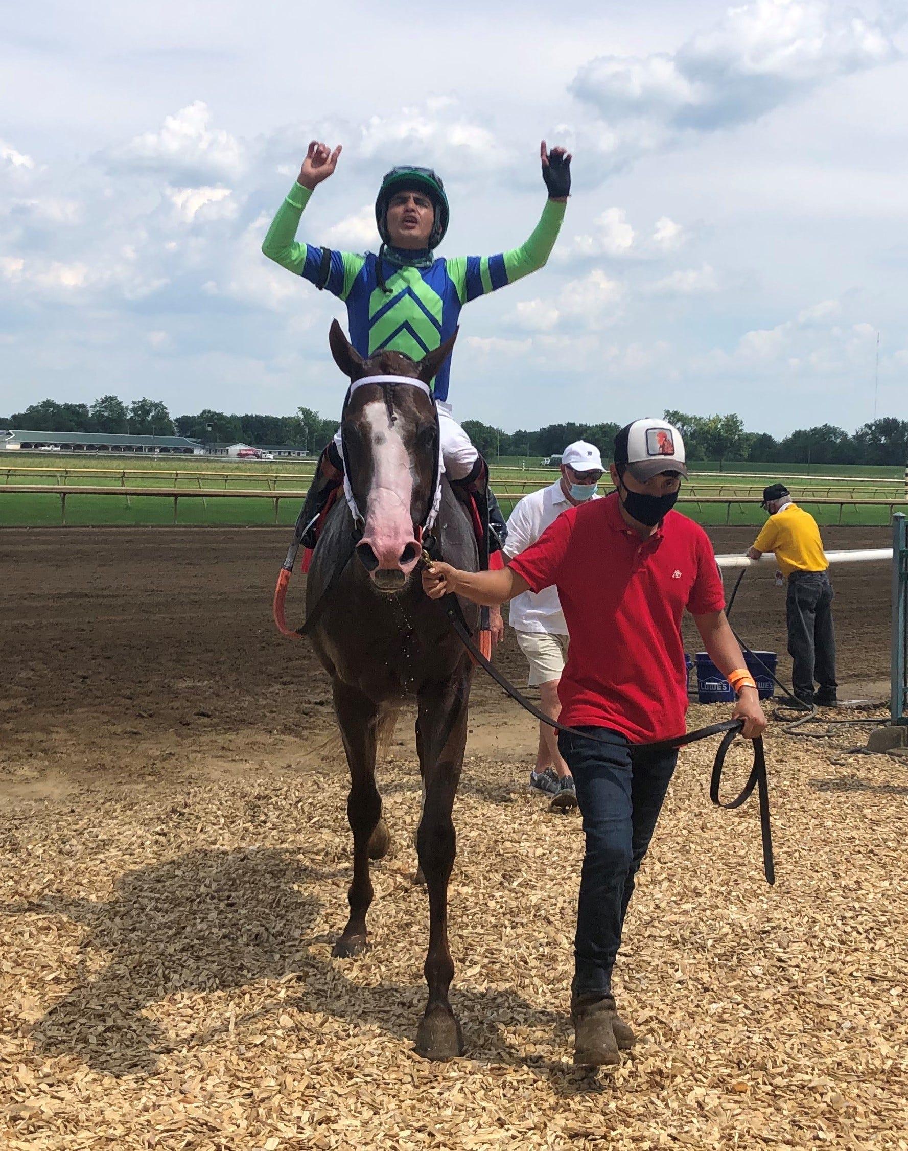 Jockey Miguel Mena gets 2,000th career win at...