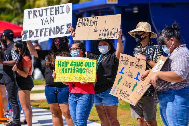 Dozens of residents line Route 3 in Dededo at a peaceful protest, held to speak out against the disruption of ancient CHamoru sites and the removal of associated artifacts during the construction of Marine Corps Camp Blaz, on Friday, July 3, 2020.