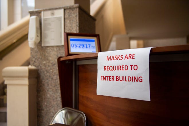 Signs are placed around that say masks are required to enter the Jackson City Hall building due to the novel Covid-19 virus, Thursday, July 2, 2020.