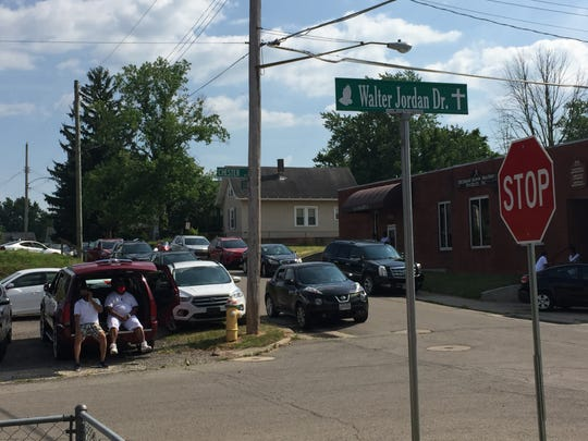 Dozens of people came out Friday for the dedication of Walter Jordan Drive, a portion of Chester Avenue between Grant and Lida streets. Jordan passed away in January.