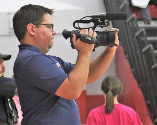 Local TV personality Travis Berardi films a game at Shelby High School during the 2019-20 high school basketball season.