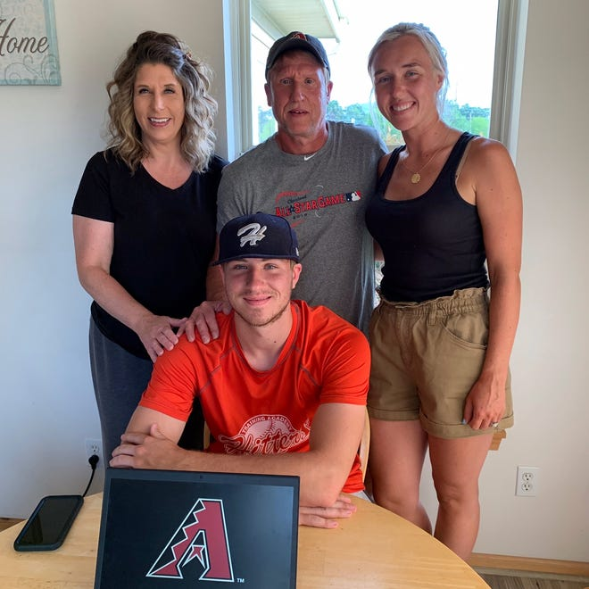 East Troy graduate AJ Vukovich (seated) poses for a picture with (from left) his mother Melissa, father, Randy, and sister, Morgan, after signing his contract with the Arizona Diamondbacks Thursday, July 2, 2020.