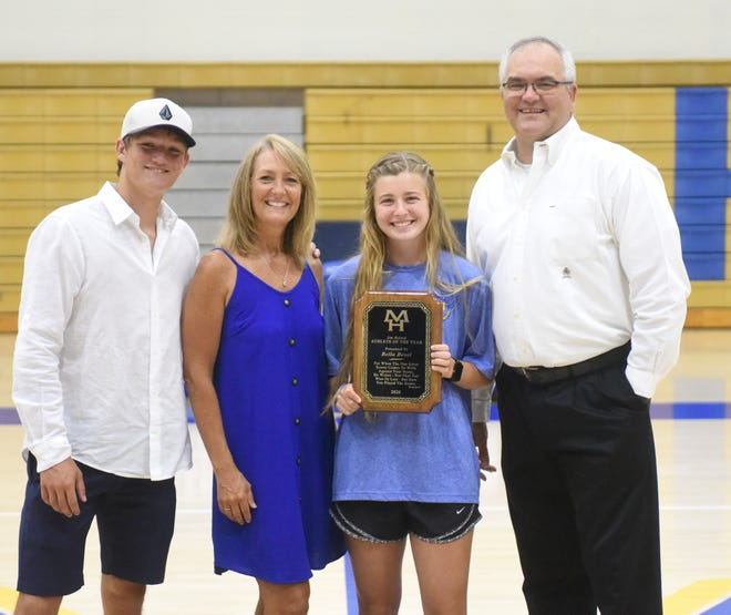 Mountain Home's Bella Bevel, a four-year letter winner on the Lady Bomber swim, softball, track and cross country teams, was the recipient of the Jim Holsted Athlete of the Year award on Friday. Pictured with Bevel are (from left) Lawson Stockton, Susan Stockton and Mike Stockton, family of the late Jim Holsted.