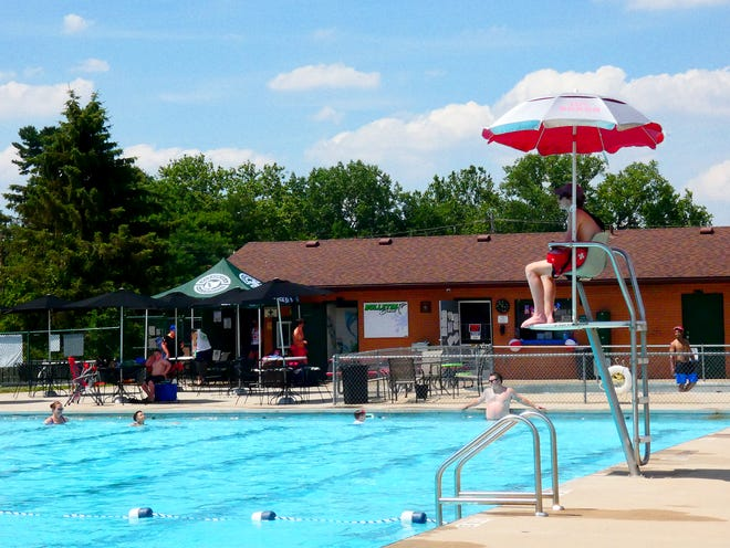 Pataskala Community Pool lifeguard Ryan Mohler keeps an eye on swimmers on the first day of the pools season on Friday, July 3, 2020.