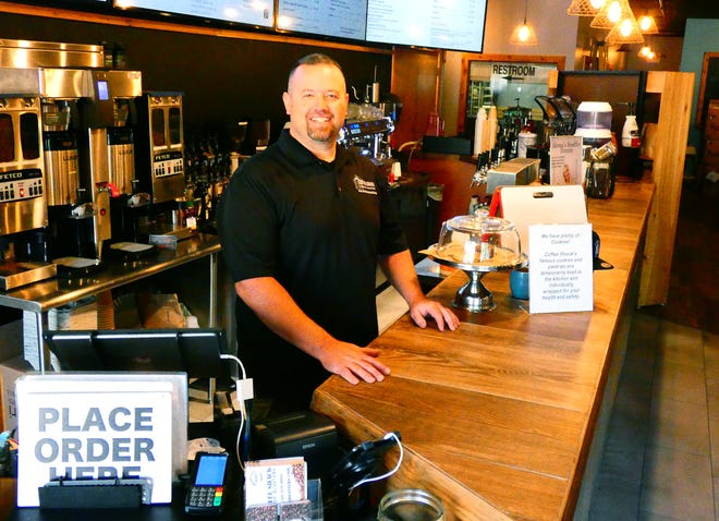 Jeff Grow in the newly renovated interior of Coffee Shack Coffee Roasters & Cafe in Heath. The cafe has reopened after renovations for take out orders as of Friday, July 3, 2020.