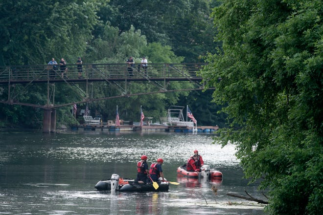 The Paterson Fire Department investigates a report of two cars in the Passaic River near McBride Avenue on Friday, July 3, 2020.