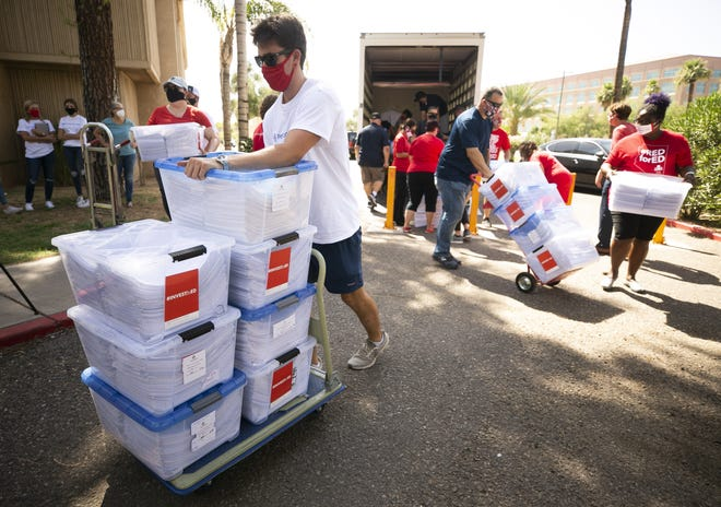 Ryan Humble, with the company Petition Partners, transports boxes containing some of the 435,669 signatures for the InvestInEd ballot initiative at the Arizona Capitol in Phoenix on July 2, 2020.