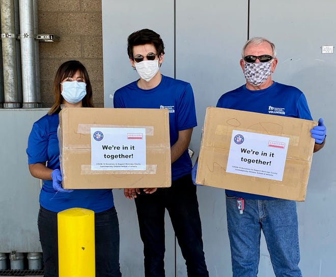 From left, Claudia Olszewski, Scott Olson and CarlLabbe drop off supplies to fight COVID-19 in Phoenix.