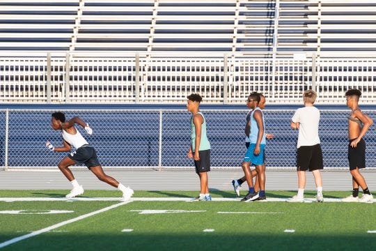 A group of Chambersburg Area Senior High School student-athletes participate in a summer football workout at Trojan Stadium on Thursday, July 2, 2020.