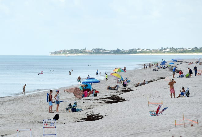 Indian River County residents make their way to local beaches on Friday, July 3, 2020, as the July 4th holiday weekend gets underway. Many Florida beaches were closed because of the COVID-19 outbreak making Indian River County beaches the southern-most beaches on Florida's east coast available to the public.