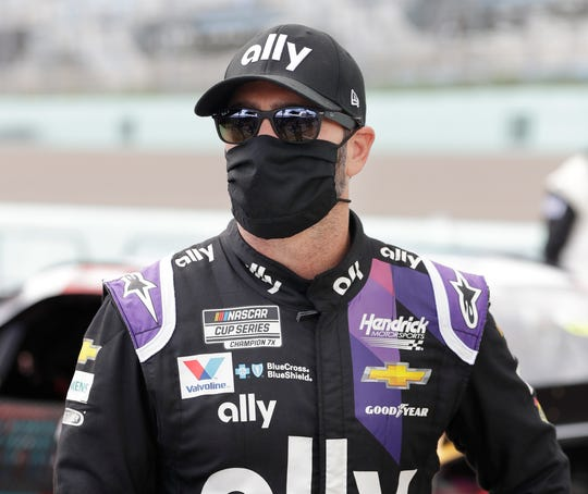 Jimmie Johnson wears a mask before the start of the NASCAR race at Homestead-Miami Speedway on June 14.