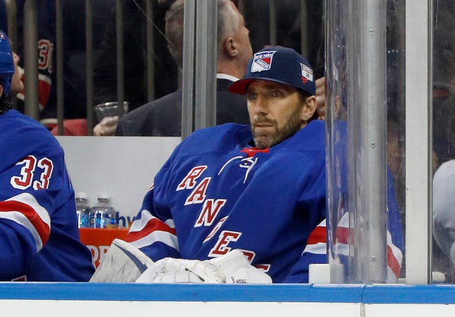 New York Rangers goaltender Henrik Lundqvist (30) looks on from the bench during an NHL hockey game against the Buffalo Sabres, Friday, Feb. 7, 2020, in New York. (AP Photo/Jim McIsaac)