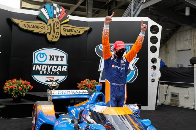 Scott Dixon celebrates winning the IndyCar GrandPrix, capturing his second career win at historic Indianapolis Motor Speedway.