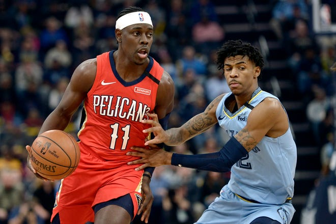 """Basketball will be easy part for Pelicans guard Jrue Holliday and Grizzlies guard Ja Morant when the NBA resumes its suspended season inside Central Florida """"bubble"""" later this month. Holliday and Morant could be away from home for more than a month and missed important family moments. Brandon Dill/AP"""