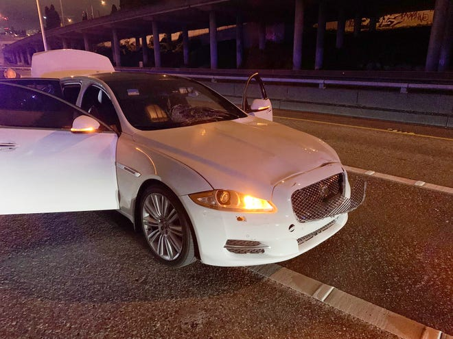 This early Saturday, July 4, 2020 photo provided by the Washington State Patrol shows the vehicle of Dawit Kelete, who is suspected of driving into a protest on Interstate 5 in Seattle.