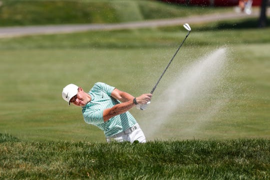Cameron Champ hits out of the fairway bunker on the 10th hole during the third round of the Rocket Mortgage Classic golf tournament at the Detroit Golf Club in Detroit, Saturday, July 4, 2020.