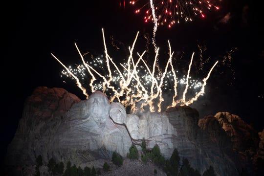 Fireworks light the sky at Mount Rushmore National Memorial, Friday near Keystone, S.D., after President Donald Trump spoke. (AP Photo/Alex Brandon)
