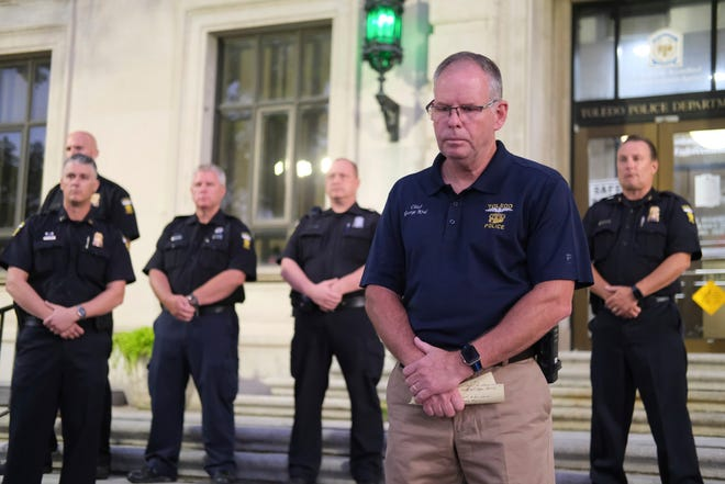 Toledo Police Chief George Kral bows his head with other officers during a news conference at the Safety Building after Toledo Police Officer Anthony Dia was shot and killed in the parking lot of a Home Depot in Toledo, Ohio early Saturday, July 4, 2020. (Dave Zapotosky/The Blade via AP)