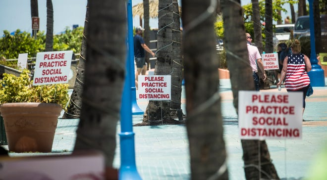The Fourth of July holiday brought visitors to Fort Myers Beach on Saturday, July 4, 2020. Images taken from the pier and Times Sqaure area. Social distancing signs because of the COVID 19 pandemic could be seen througout the area including Times Square.