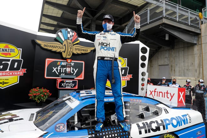 NASCAR Xfinity Series driver Chase Briscoe celebrates winning the NASCAR Xfinity Series auto race at Indianapolis Motor Speedway in Indianapolis, Saturday, July 4, 2020.