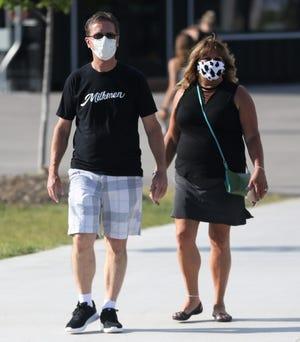 Milwaukee Milkmen fans enter the ballpark wearing masks prior to the team's season opener against the Chicago Dogs on July 3, 2020.