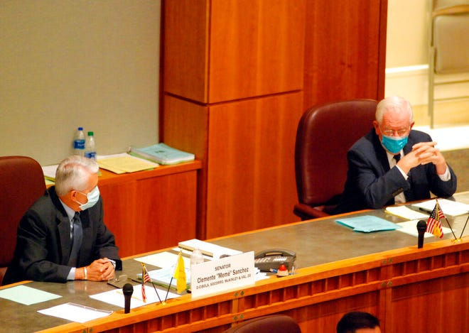 Democratic Senators Clemente Sanchez of Grants, left, and John Arthur Smith, of Deming, listen to a tribute from colleagues during a special session Saturday, June 20, 2020. The session may be their last after losing in the June 2 primary to more progressive contenders. The New Mexico Legislature met in a special session to address a gaping budget hole linked to the coronavirus and economic upheaval.