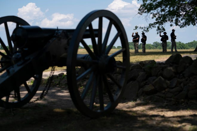 Members of a Department of Homeland Security police force stand guard at the North Carolina monument in the Gettysburg National Military Park Saturday, July 4, 2020 in Gettysburg, Pa. (AP Photo/Carolyn Kaster)