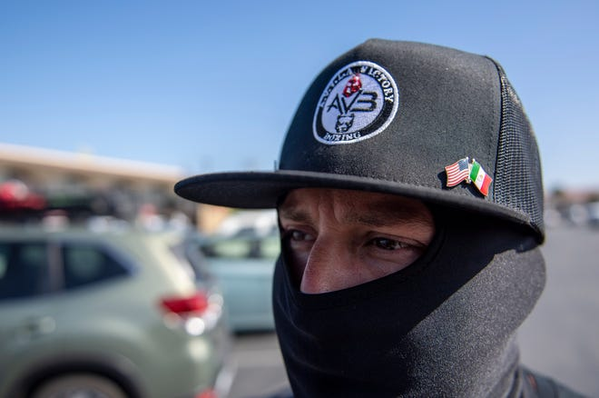 Rigo Avila, looks toward the crowd of people gathering for the Monterey County Black & Brown Solidarity Coalition in Salinas, Calif., on Friday, July 3, 2020.