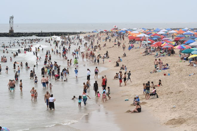 Thousands enjoyed the summer weather in Ocean City, MD Saturday, July 4, 2020 by visting the beach and the boardwalk. (Photo by Todd Dudek for The Daily Times)