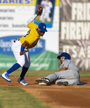 Canaries infielder Alay Lago attempts to tag Saints outfielder Justin Byrd out during the season opener on Friday, July 3, 2020 in Sioux Falls, S.D.