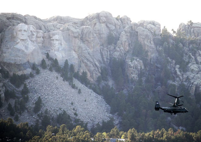 KEYSTONE, SOUTH DAKOTA - JULY 03: A V-22 Osprey, carrying members of U.S. President Donald Trump's entourage, flies past Mount Rushmore National Monument ahead of a scheduled fireworks display on July 03, 2020 near Keystone, South Dakota. President Donald Trump is scheduled to speak before the start of the fireworks display, the first at the monument in about a decade. (Photo by Scott Olson/Getty Images)