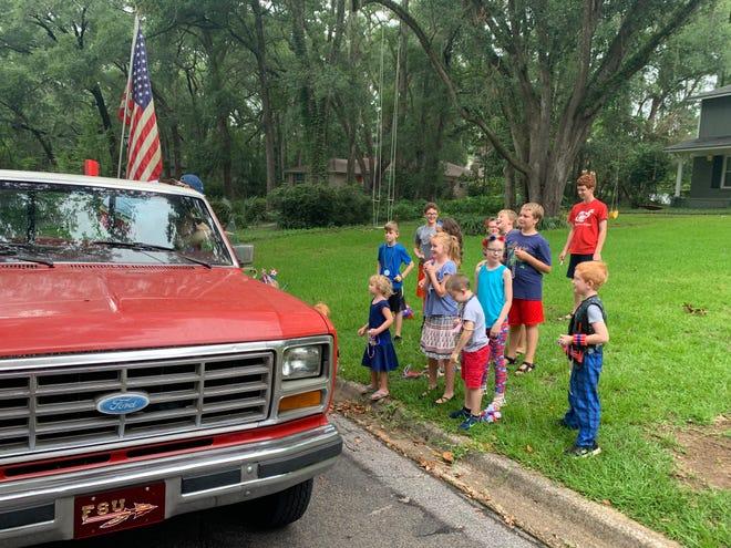 Tom and Lynda Derzypolski arrange a Fourth of July parade in the Killearn neighborhood for their grandchildren.