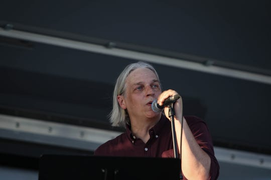 """Rock Orchestra, a Delaware-based tribute organization, performs Beatles hits in a parking lot outside of Frawley Stadium as part of The Grands """"Concerts by Car"""" series during the coronavirus pandemic on Friday, July 3, 2020."""
