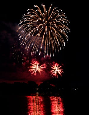 Fireworks light up the clear, warm night over the lake at Nelson Park on July 4, 2020.