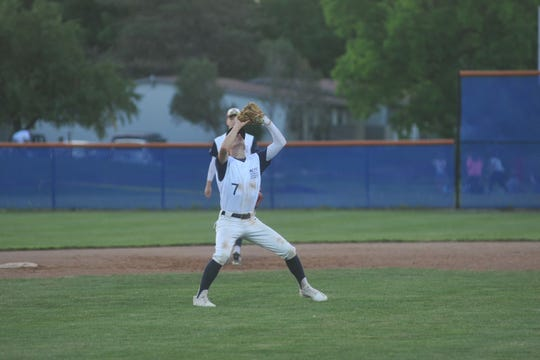 Colonel Crawford's Trevin Fairchild catches an infield pop-up.