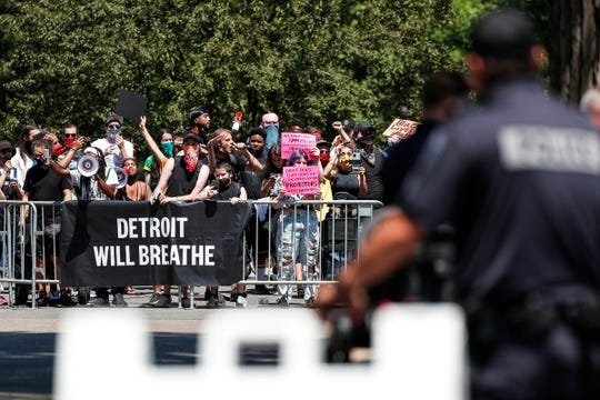 Detroit Will Breathe protesters chant Black Lives Matter during the fourth round of the Rocket Mortgage Classic golf tournament outside of the Detroit Golf Club in Detroit, Sunday, July 5, 2020.